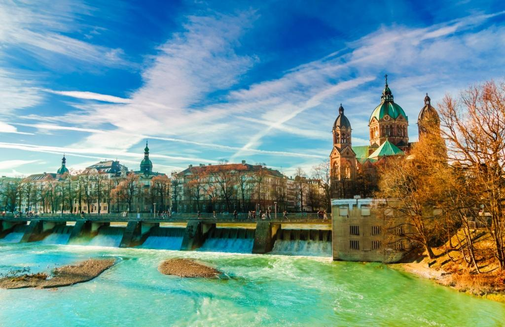 Winter landscape by turquoise Isar and St. Anna church in Munich