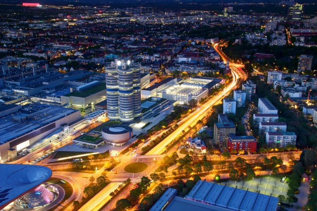 Modern European city in blue hour lit by street and car lights