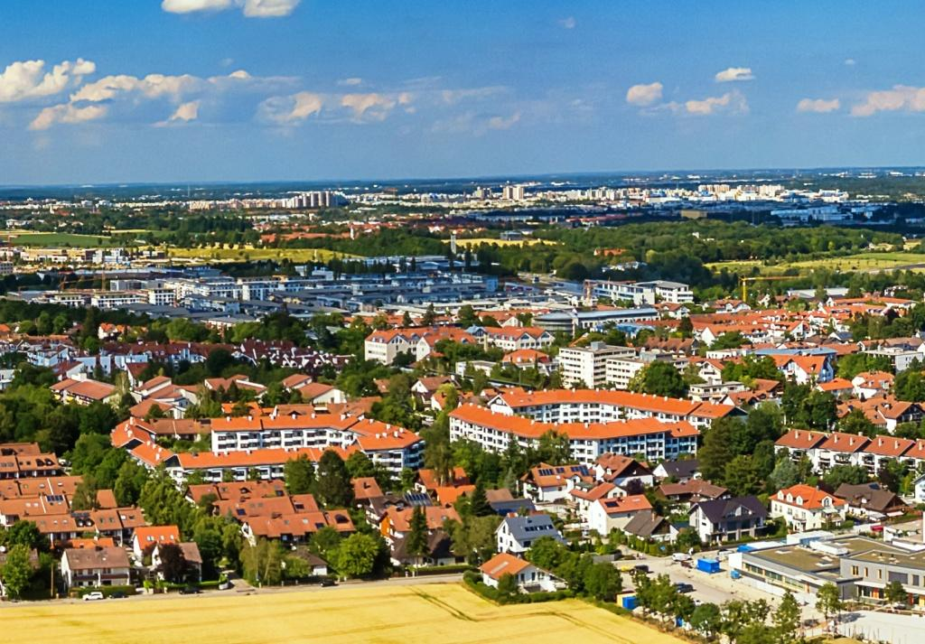 Aerial view from drone over yellow fields with a german city in background